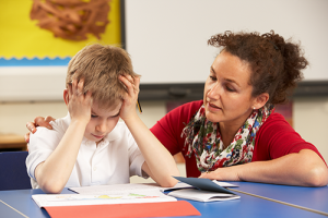 Teacher talking to frustrated student
